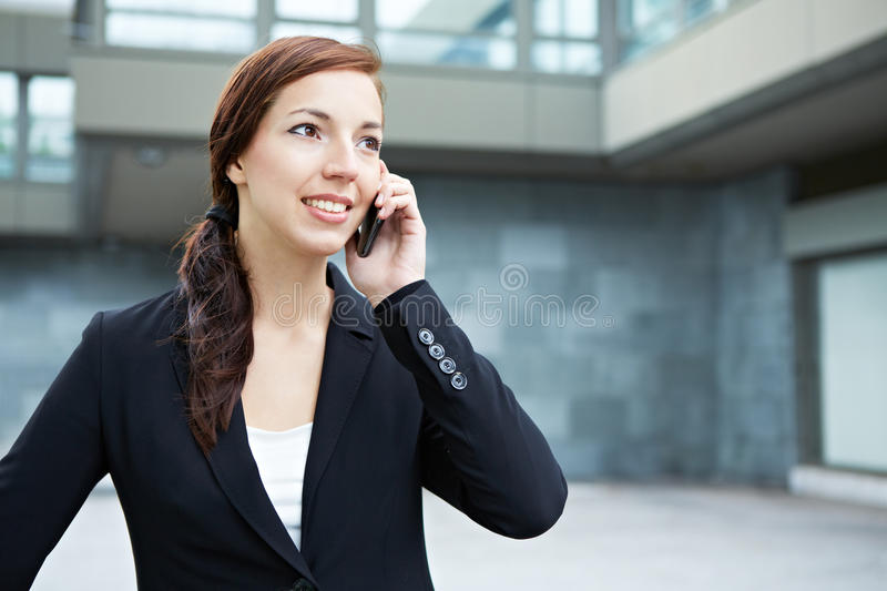 Student making call with smartphone royalty free stock images