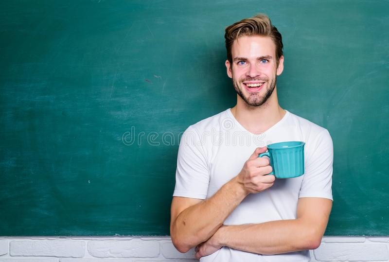 Student man in classroom. Time for rest. energy and inspiration for education. college life. school teacher need coffee. Break. good morning. back to school stock photo