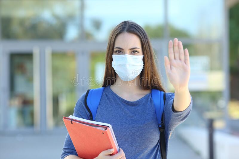 Student with a mask gesturing stop royalty free stock photography