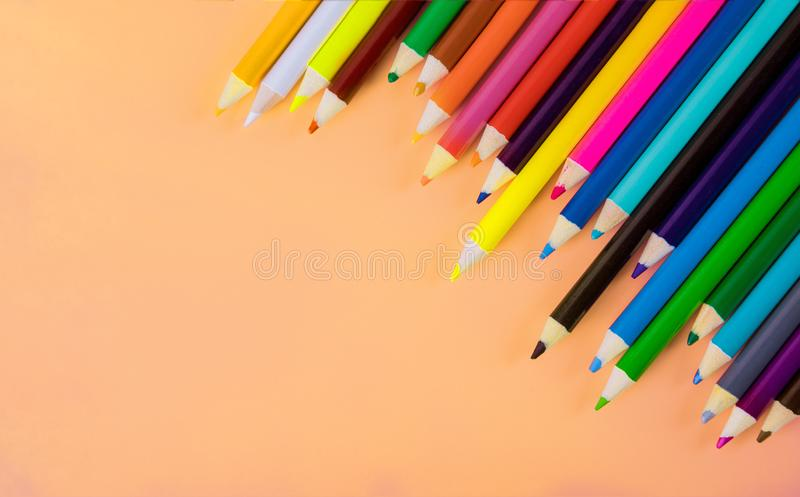 Student material on orange table, back to school stock photography