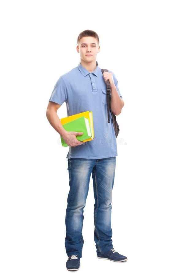 Student med böcker och ryggsäcken som isoleras på vit royaltyfria bilder