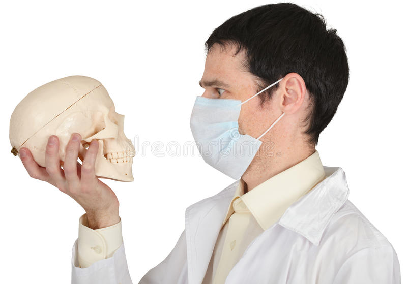 Download Student Medical School In Mask Looks At Skull Stock Image - Image: 13033843