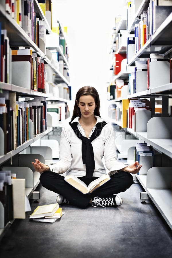 Download Student Meditating Over A Book In Library. Stock Photo - Image: 15437560