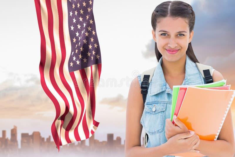 Student mot amerikanska flaggan royaltyfria foton