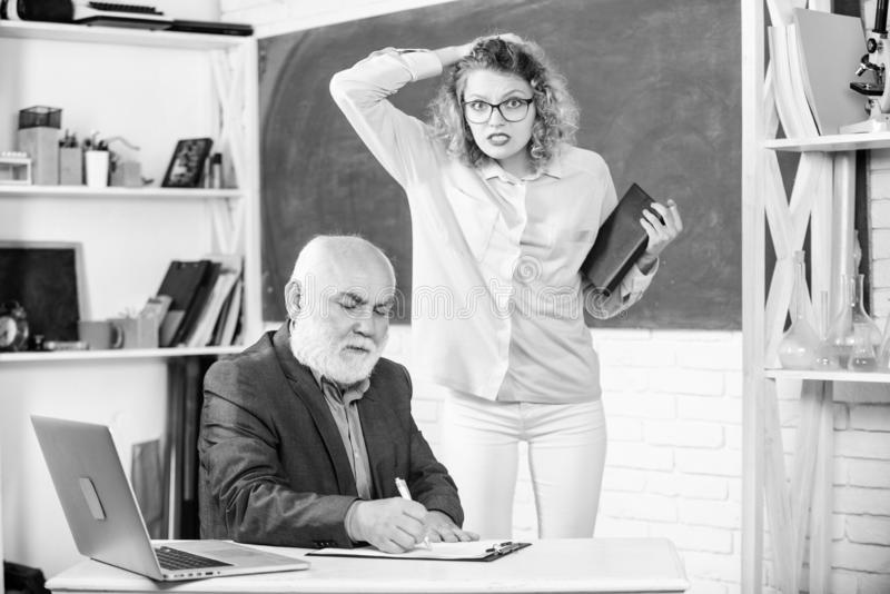 Student nervous about mark. School education concept. Check homework. Educator and student in classroom. Student girl royalty free stock image