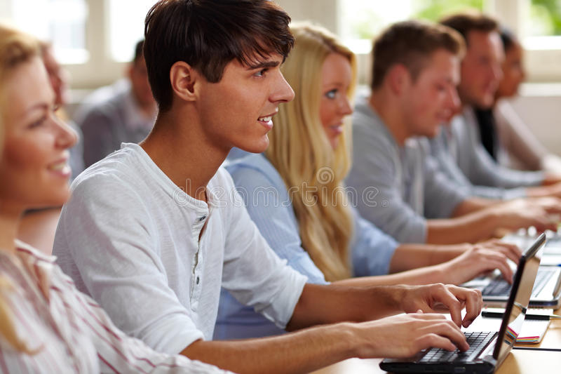Student with netbook in class royalty free stock photos