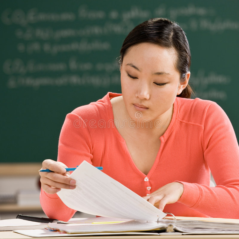 Student with notebook doing homework stock image