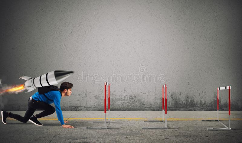 Student overcomes obstacles of his studies at top speed with a rocket stock photo