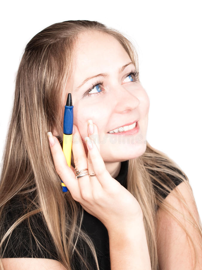 Student with a pen in hand stock photo