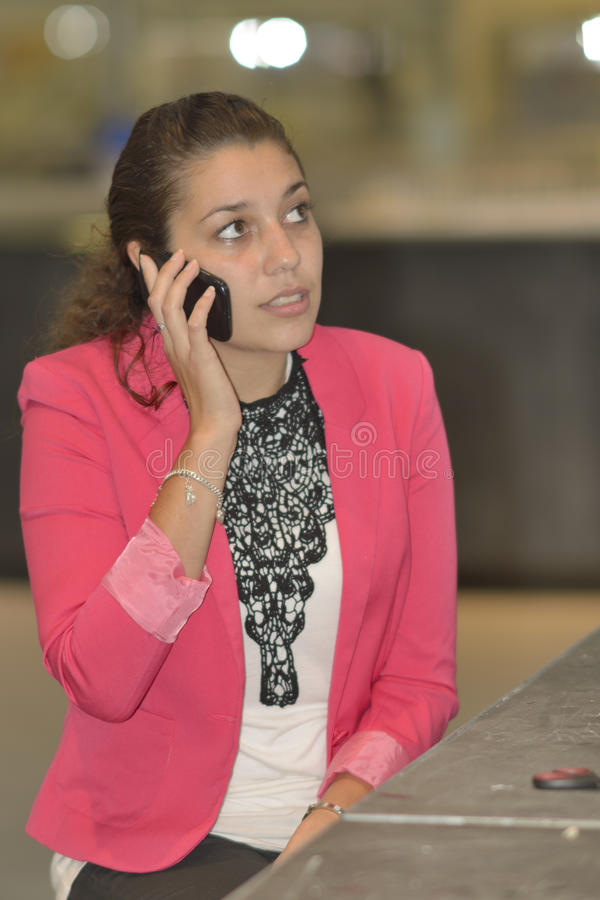 Student phoning in design lab royalty free stock photos
