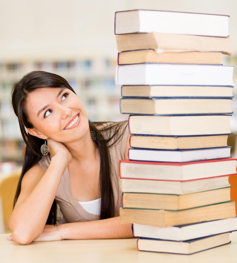 Student with a pile of books