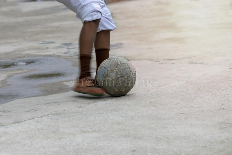 A student is playing football after school. Children playing football after school.n royalty free stock photo