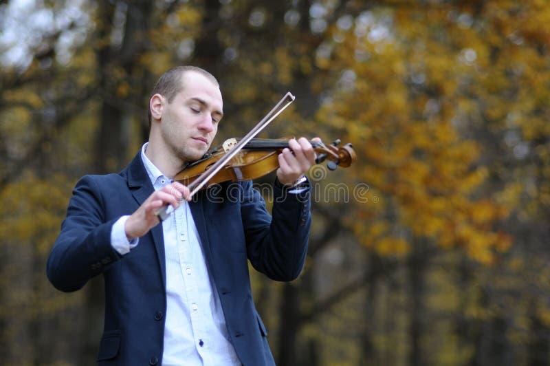 Student playing at violin stock image