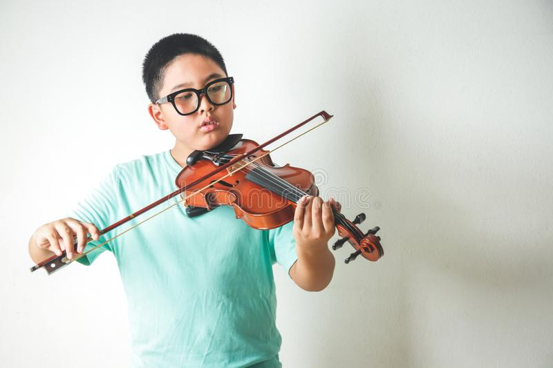 The student plays the violin in the room. royalty free stock photography