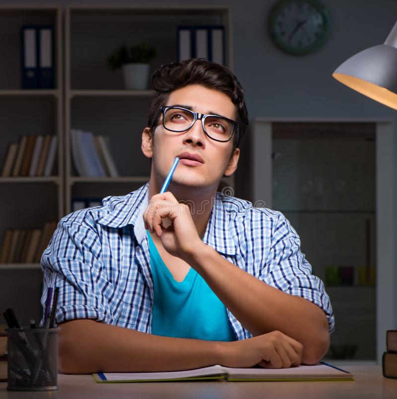 Student preparing for exams late night at home. The student preparing for exams late night at home stock images