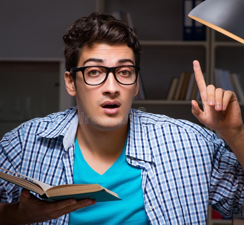 Student preparing for exams late night at home. The student preparing for exams late night at home royalty free stock image