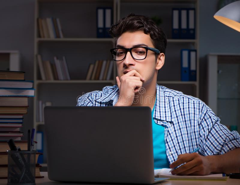 Student preparing for exams late night at home. The student preparing for exams late night at home royalty free stock photo