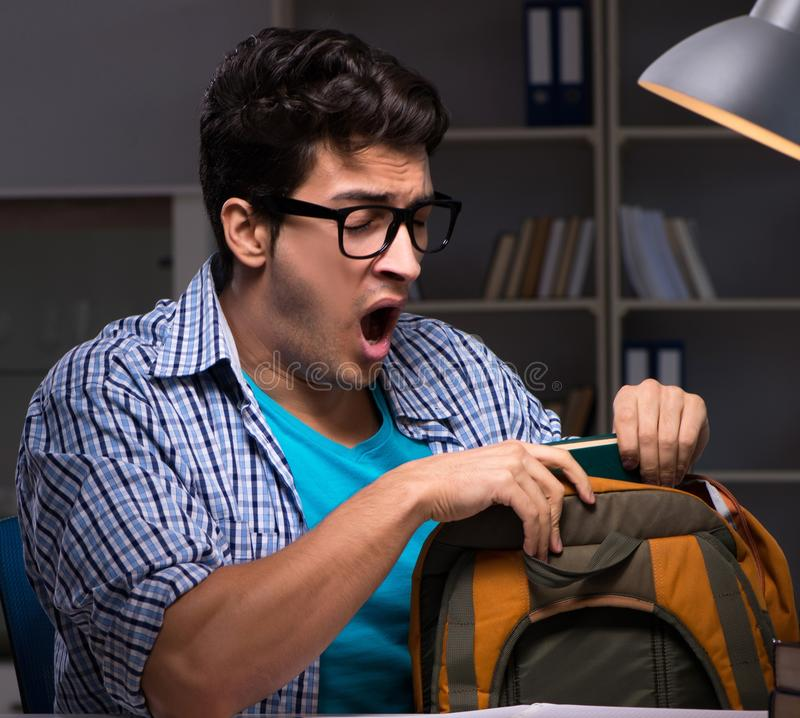 Student preparing for exams late night at home. The student preparing for exams late night at home stock photography