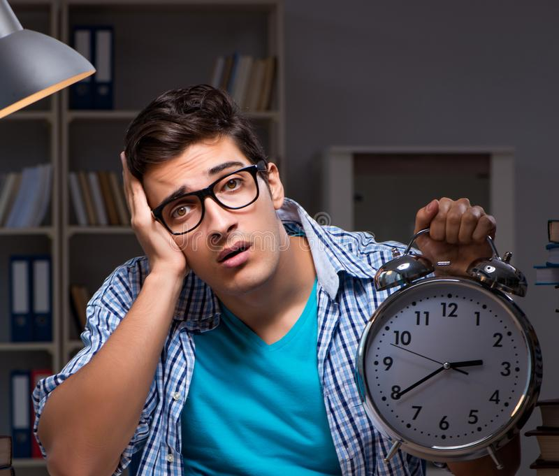 Student preparing for exams late night at home. The student preparing for exams late night at home stock photo
