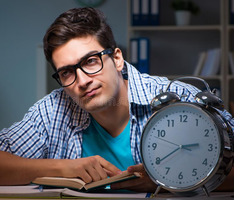 Student preparing for exams late night at home. The student preparing for exams late night at home royalty free stock photos