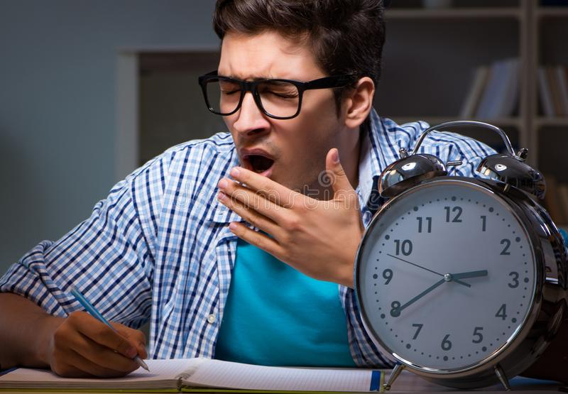 Student preparing for exams late night at home. The student preparing for exams late night at home royalty free stock images