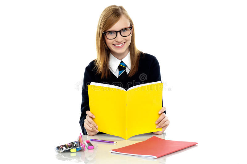 Student preparing for her upcoming assessments. Studious student wearing spectacles preparing for her upcoming assessments stock photo