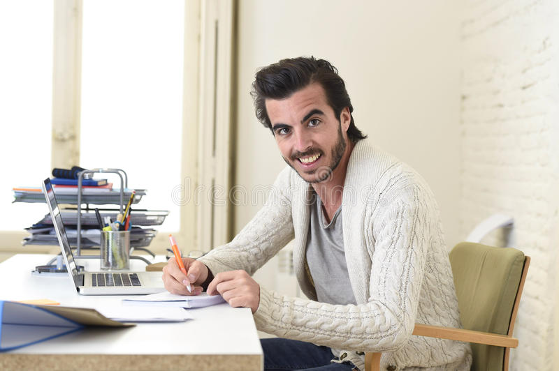 Student preparing university project or hipster style freelancer businessman working with laptop royalty free stock image