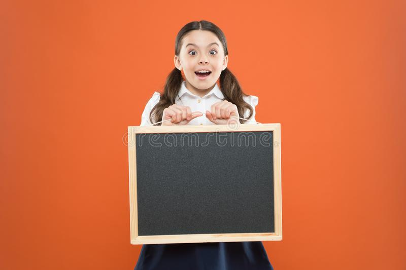 Student rating. happy teachers day. 1 september. small girl demonstrate announcement. happy small school girl with royalty free stock image