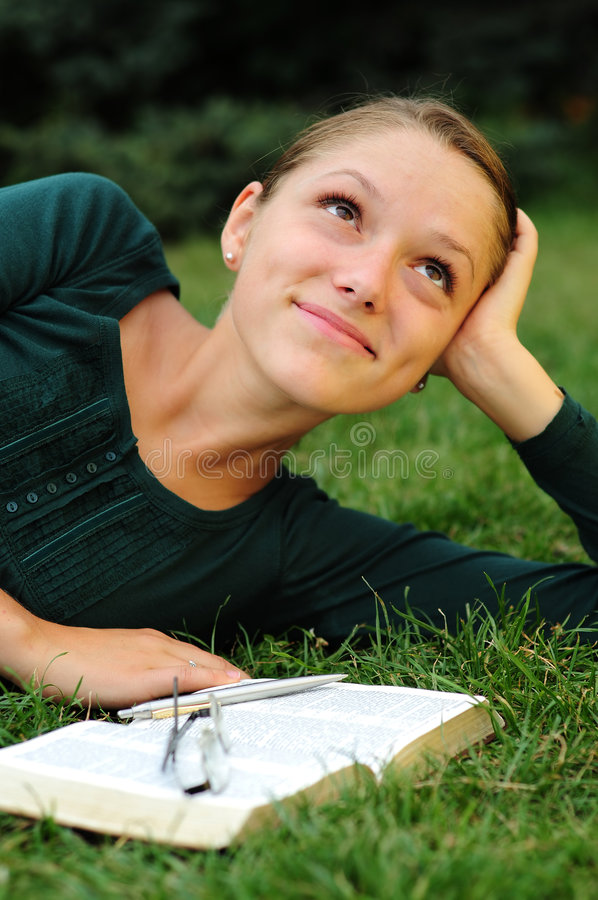 Student Reading. In a public park royalty free stock photo
