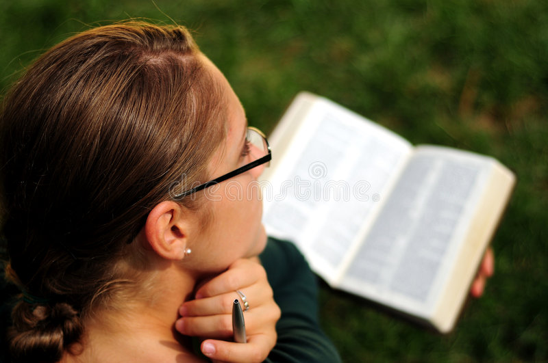 Student Reading. Sisters Reading in a public park royalty free stock photos