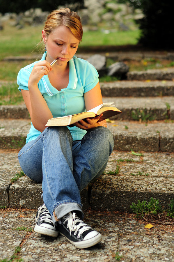 Student Reading. In a public park royalty free stock photography