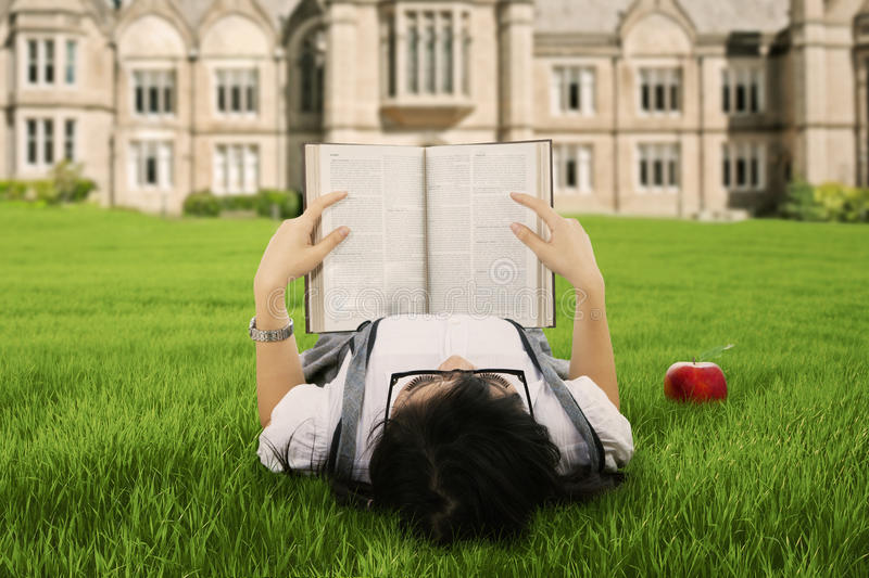 A student reading a book outdoor stock photography