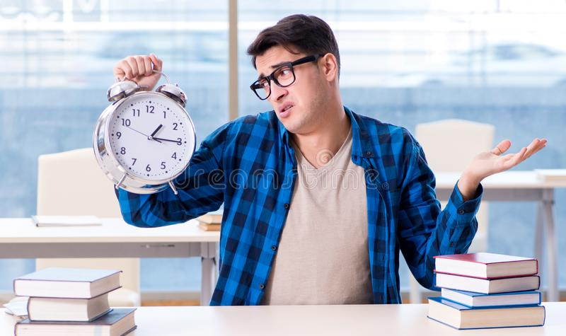 The student running out of time to prepare for exam in college stock photography