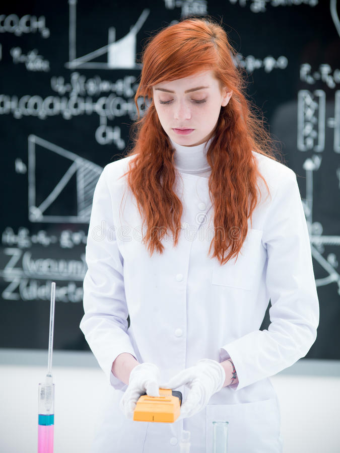 Student Scanning In Chemistry Lab Royalty Free Stock Image