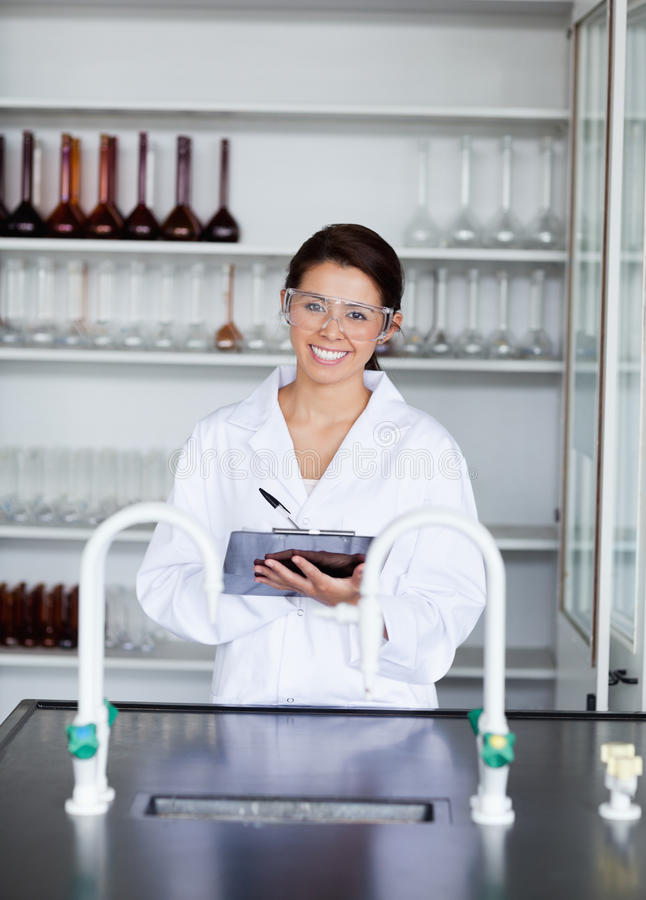 A Student In Science Writing On A Clipboard Stock Photography