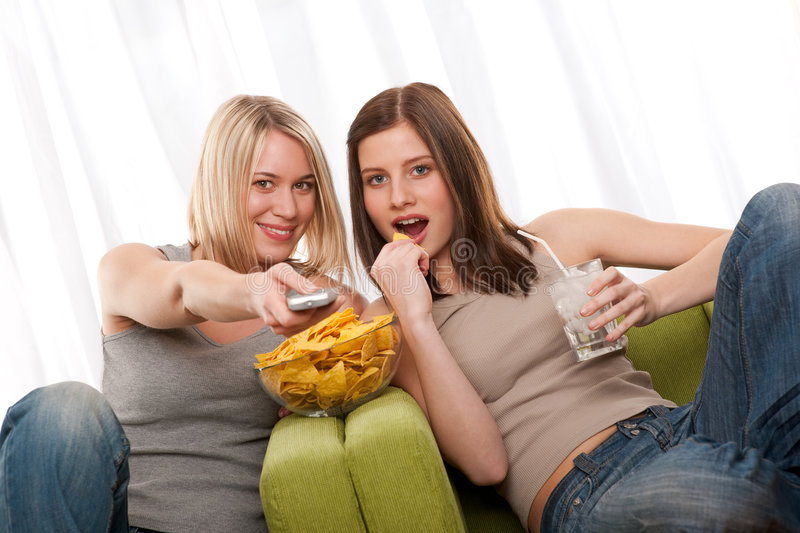 Student Series - Two Teenage Girls Watching TV Royalty Free Stock Photography