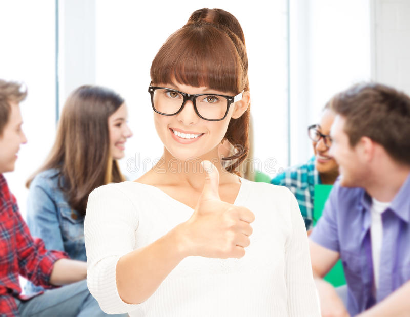 Student showing thumbs up at school royalty free stock photos