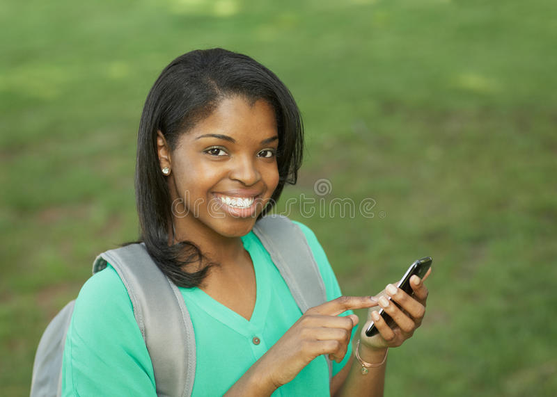Download Student with smart phone stock photo. Image of college - 25217828