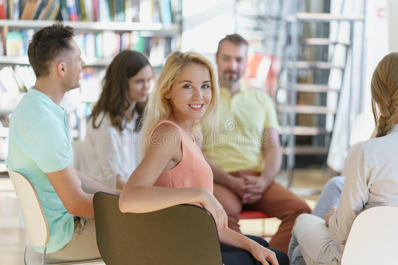 Student. Smiling women in a library stock images