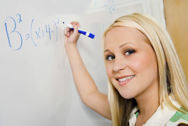 Student Solving Algebra Equation On Whiteboard stock photos
