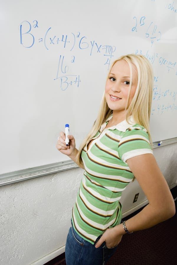 Student Solving Algebra Equation On Whiteboard stock photography