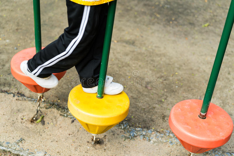 Student stepping on playground equipment royalty free stock photography