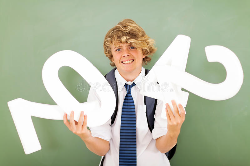 Student struggling maths. Male high school student is struggling with maths subject royalty free stock image