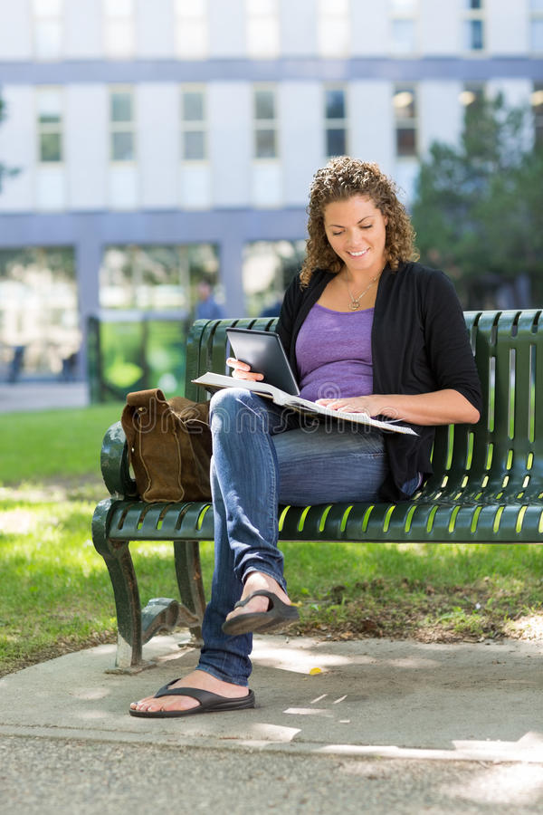 Student Studying On Bench At University Campus royalty free stock photos