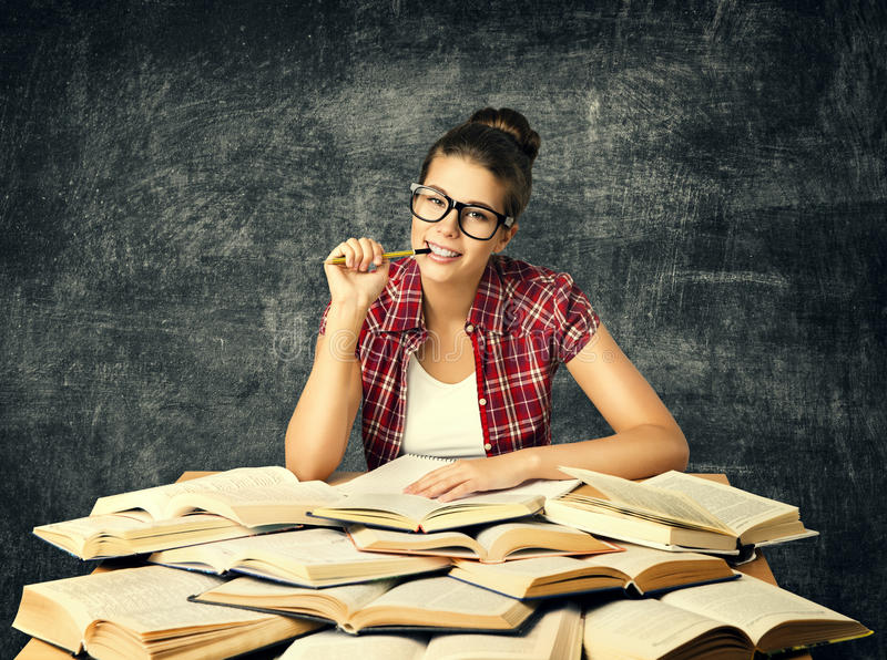 Student Studying Books, Young University Woman Read Many Book over Blackboard royalty free stock photography