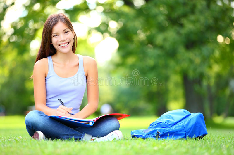 Student studying in park royalty free stock image