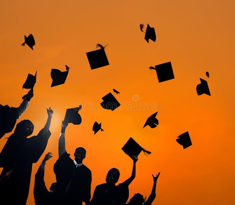 Student Success Concept för berömutbildningsavläggande av examen arkivfoto