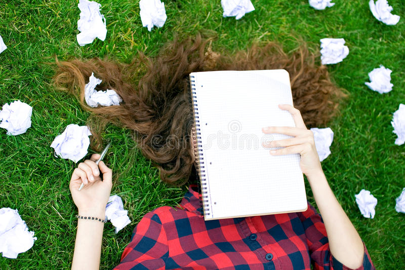 Student Surrounded by Crumpled Paper royalty free stock photo