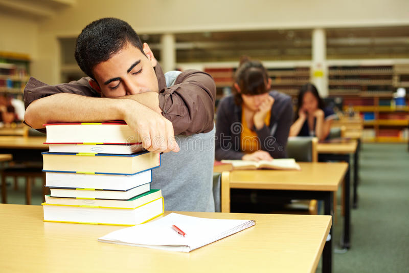 Student taking a nap stock photography