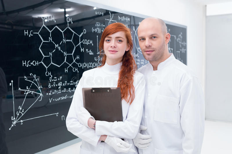 Download Student And Teacher At Blackboard Stock Photo - Image: 31257900